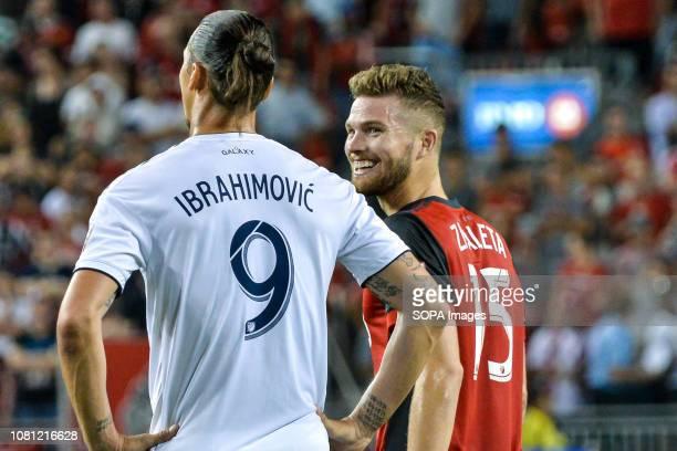 Zlatan Ibrahimovic and Eriq Zavaleta during 2018 MLS Regular Season match between Toronto FC and LA Galaxy at BMO Field .