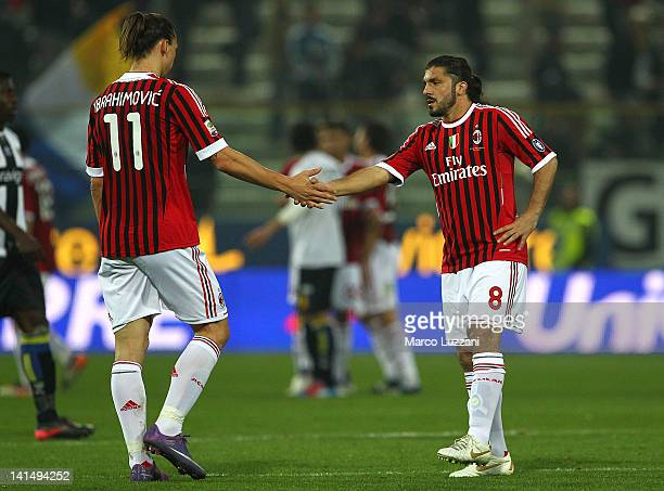 Zlatan Ibrahimovic and Gennaro Gattuso of AC Milan celebrate a victory at the end of the Serie A match between Parma FC and AC Milan at Stadio Ennio...