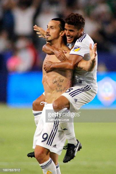 Zlatan Ibrahimovic and Jonathan Dos Santos of the Los Angeles Galaxy celebrate Irahimovic's third goal of the game at StubHub Center on July 29 2018...