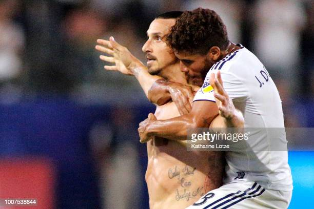 Zlatan Ibrahimovic and Jonathan Dos Santos of the Los Angeles Galaxy celebrate Ibrahimovic's third goal of the game at StubHub Center on July 29 2018...