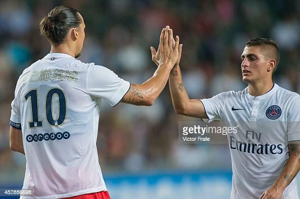 Zlatan Ibrahimovic and Marco Verratti of Paris SaintGermain celebrate a goal during the friendly match between Kitchee and Paris SaintGermain at Hong...