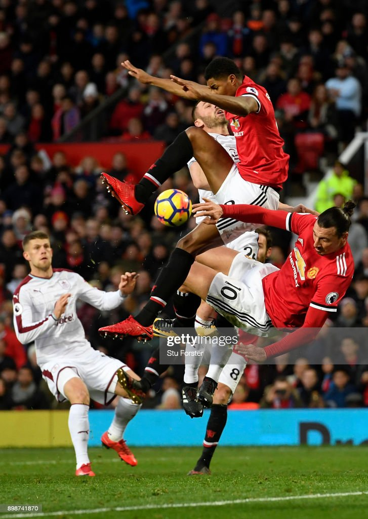 Zlatan Ibrahimovic and Marcus Rashford of Manchester United clash with Phil Bardsley of Burnley during the Premier League match between Manchester United and Burnley at Old Trafford on December 26, 2017 in Manchester, England.