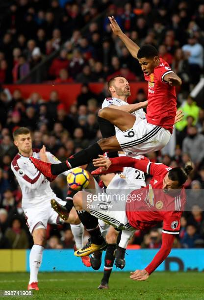 Zlatan Ibrahimovic and Marcus Rashford of Manchester United clash with Phil Bardsley of Burnley during the Premier League match between Manchester...