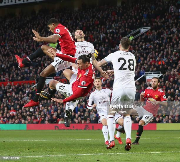 Zlatan Ibrahimovic and Marcus Rashford of Manchester United collide during the Premier League match between Manchester United and Burnley at Old...