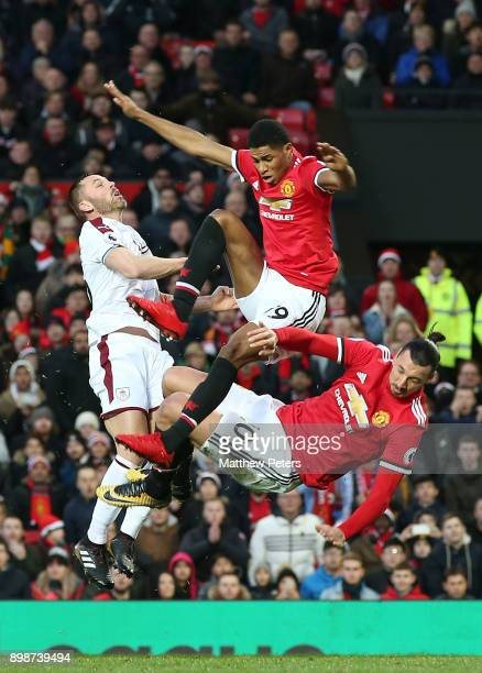 Zlatan Ibrahimovic and Marcus Rashford of Manchester United icollide during the Premier League match between Manchester United and Burnley at Old...