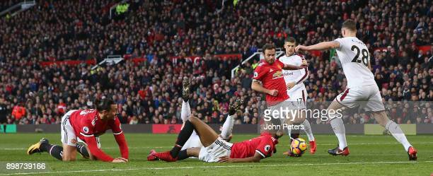 Zlatan Ibrahimovic and Marcus Rashford of Manchester United lie injured after colliding during the Premier League match between Manchester United and...