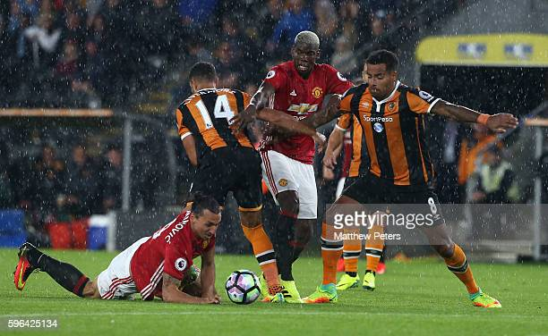 Zlatan Ibrahimovic and Paul Pogba of Manchester United in action with Jake Livermore and Tom Huddlestone of Hull City during the Premier League match...