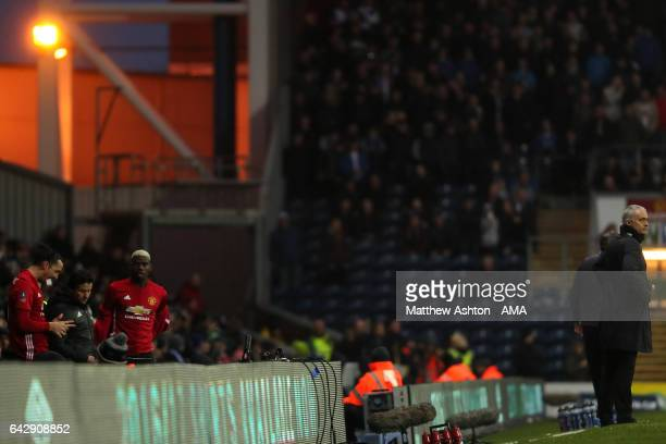 Zlatan Ibrahimovic and Paul Pogba of Manchester United prepare to come on as substitutes as Manager / Head Coach Jose Mourinho looks on during the...