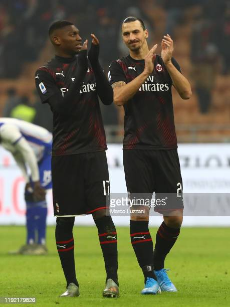 Zlatan Ibrahimovic and Rafael Leao of AC Milan salute the crowd at the end of the Serie A match between AC Milan and UC Sampdoria at Stadio Giuseppe...