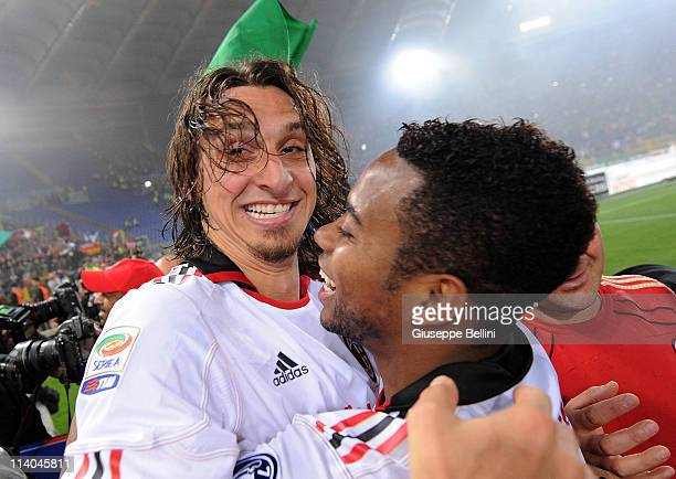 Zlatan Ibrahimovic and Robinho of Milan celebrate the victory after the Serie A match between AS Roma and AC Milan at Stadio Olimpico on May 7 2011...