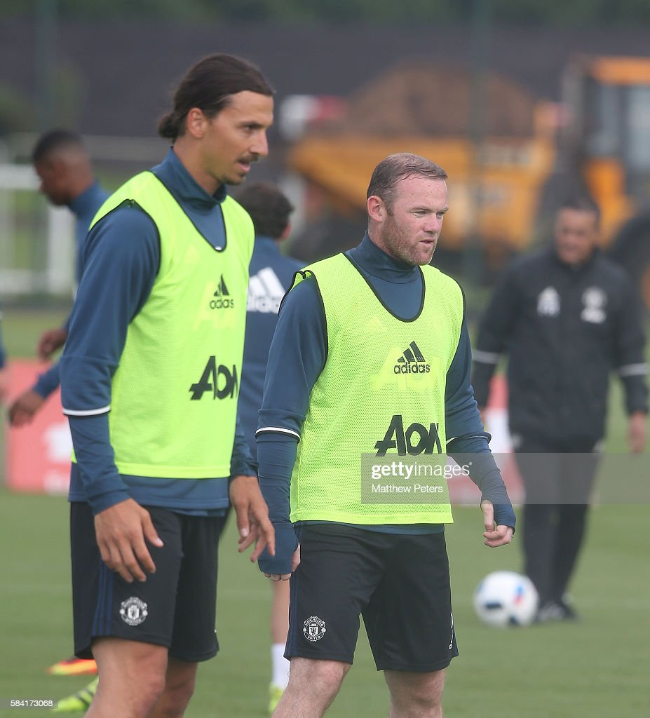 Zlatan Ibrahimovic and Wayne Rooney of Manchester United in action during a first team training session at Aon Training Complex on July 28, 2016 in Manchester, England.