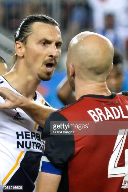 Zlatan Ibrahimovic argues with Michael Bradley during 2018 MLS Regular Season match between Toronto FC and LA Galaxy at BMO Field .