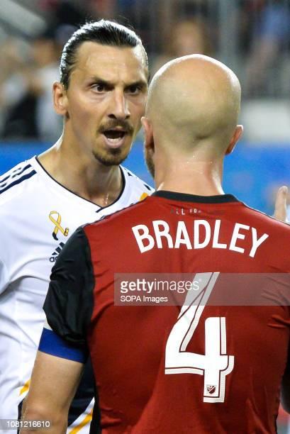 BMO FIELD TORONTO ONTARIO CANADA Zlatan Ibrahimovic argues with Michael Bradley during 2018 MLS Regular Season match between Toronto FC and LA Galaxy...