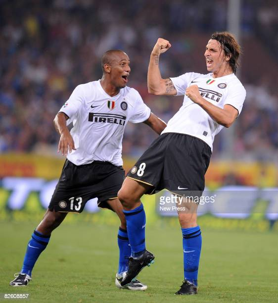 Zlatan Ibrahimovic celebrates with Douglas Maicon after scoring during the Serie A match between Sampdoria and Inter at the Stadio Marassi on August...
