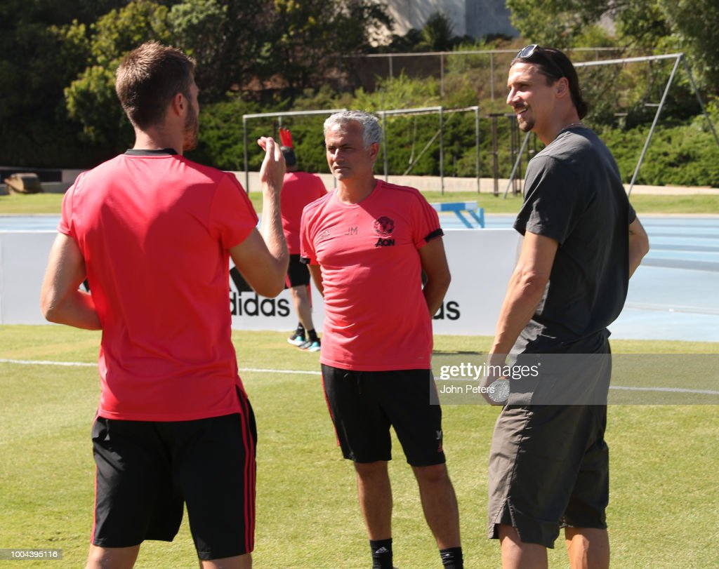 Zlatan Ibrahimovic chats to Manchester United Manager / Head Coach Jose Mourinho and Michael Carrick during a Manchester United pre-season training session at UCLA on July 23, 2018 in Los Angeles, California.