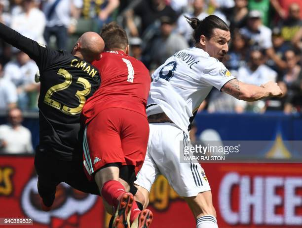 Zlatan Ibrahimovic from LA Galaxy heads to score against Laurent Ciman and goalkeeper Tyler Miller of LAFC during their Major League Soccer game at...