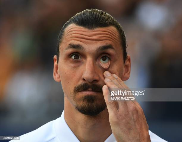 TOPSHOT Zlatan Ibrahimovic from LA Galaxy reacts from the bench during their Major League Soccer game against Sporting Kansas City at the StarHub...
