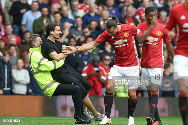 Zlatan Ibrahimovic look a like invades the pitch during the Premier League match between Manchester United and Leicester City at Old Trafford on...