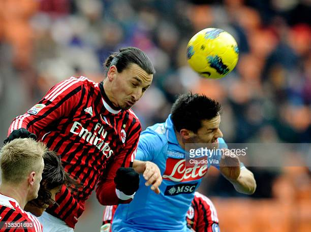 Zlatan Ibrahimovic of AC Milan and Christian Maggio of SSC Napoli compete for the ball during the Serie A match between AC Milan and SSC Napoli at...