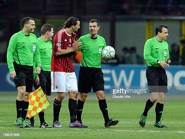 Zlatan Ibrahimovic of AC Milan and referee Viktor Kassai during the UEFA Champions League round of 16 first leg match between AC Milan and Arsenal FC...