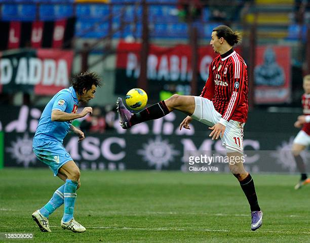 Zlatan Ibrahimovic of AC Milan and Salvatore Aronica of SSC Napoli compete for the ball during the Serie A match between AC Milan and SSC Napoli at...