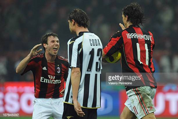 Zlatan Ibrahimovic of AC Milan celebrates a goal with teammate Antonio Cassano during the Serie A match between AC Milan and Udinese Calcio at Stadio...