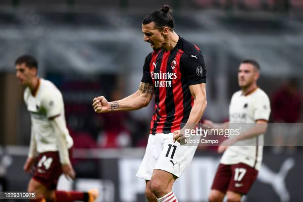 Zlatan Ibrahimovic of AC Milan celebrates after scoring a goal during the Serie A football match between AC Milan and AS Roma The match ended 33 tie