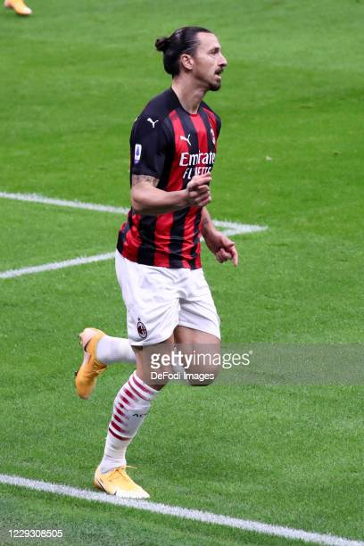 Zlatan Ibrahimovic of AC Milan celebrates after scoring his team's first goal during the Serie A match between AC Milan and AS Roma at Stadio...