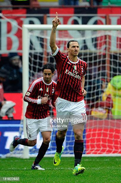 Zlatan Ibrahimovic of AC Milan celebrates after scoring the first goal during the Serie A match between AC Milan and Catania Calcio at Stadio...