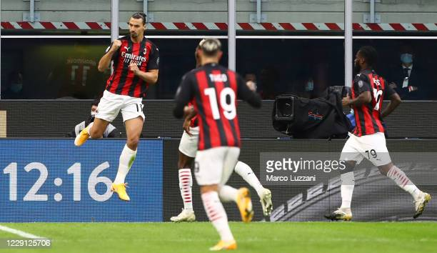 Zlatan Ibrahimovic of AC Milan celebrates after scoring the opening goal during the Serie A match between FC Internazionale and AC Milan at Stadio...