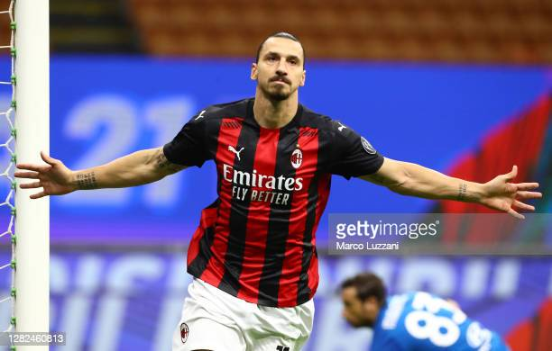Zlatan Ibrahimovic of AC Milan celebrates after scoring the opening goal during the Serie A match between AC Milan and AS Roma at Stadio Giuseppe...