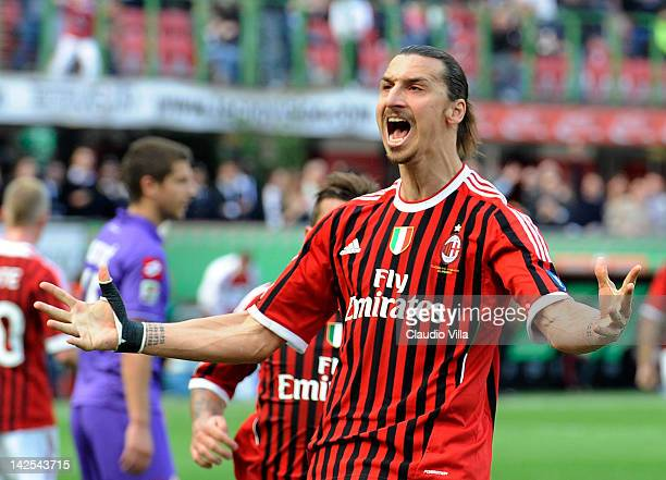 Zlatan Ibrahimovic of AC Milan celebrates after scoring the opening goal from a penalty during the Serie A match between AC Milan and ACF Fiorentina...