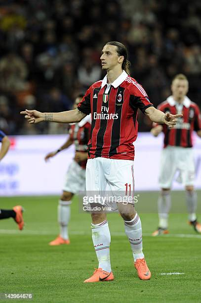 Zlatan Ibrahimovic of AC Milan celebrates after scoring their first goal during the Serie A match between FC Internazionale Milano and AC Milan at...