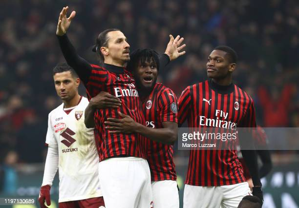 Zlatan Ibrahimovic of AC Milan celebrates his goal with his team-mates Franck Kessie and Rafael Leao during the Coppa Italia Quarter Final match...
