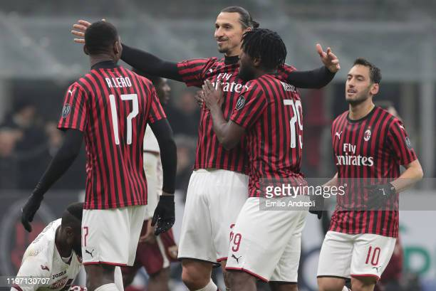 Zlatan Ibrahimovic of AC Milan celebrates his goal with his teammates during the Coppa Italia Quarter Final match between AC Milan and Torino at San...