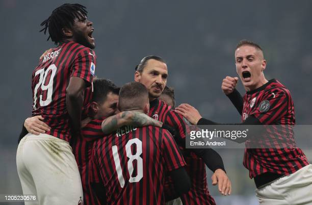 Zlatan Ibrahimovic of AC Milan celebrates his goal with his teammates during the Serie A match between FC Internazionale and AC Milan at Stadio...