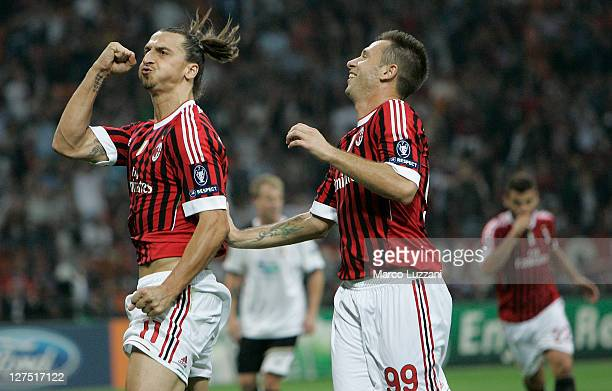 Zlatan Ibrahimovic of AC Milan celebrates his goal with teammates Antonio Cassano during the UEFA Champions League group H match between AC Milan and...