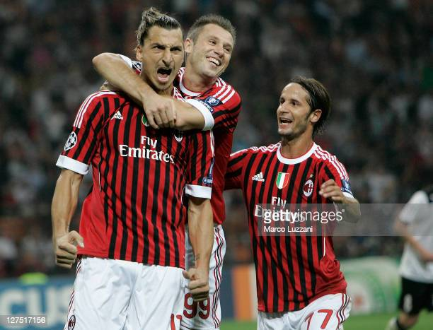 Zlatan Ibrahimovic of AC Milan celebrates his goal with teammates Antonio Cassano and Luca Antonini during the UEFA Champions League group H match...