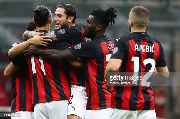 Zlatan Ibrahimovic of AC Milan celebrates his second goal with his teammates during the Serie A match between AC Milan and Bologna FC at Stadio...