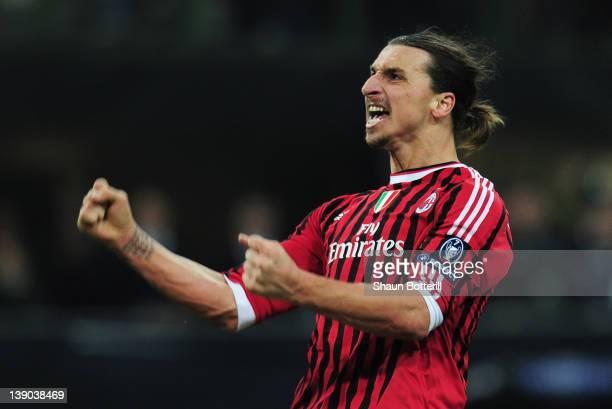 Zlatan Ibrahimovic of AC Milan celebrates scoring his penalty during the UEFA Champions League round of 16 first leg match between AC Milan and...
