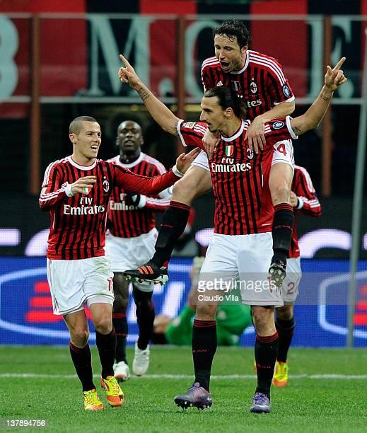 Zlatan Ibrahimovic of AC Milan celebrates scoring the first goal during the Serie A match between AC Milan and Cagliari Calcio at Stadio Giuseppe...