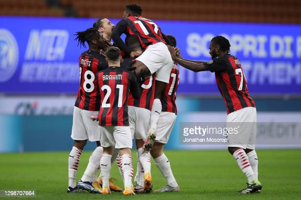 Zlatan Ibrahimovic of AC Milan celebrates with team mates after scoring to give the side a 1-0 lead during the Coppa Italia match between FC...