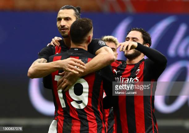 Zlatan Ibrahimovic of AC Milan celebrates with team mates Theo Hernandez and Davide Calabria after scoring their side's second goal during the Serie...