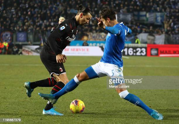 Zlatan Ibrahimovic of AC Milan competes for the ball with Ales Mateju of Brescia Calcio during the Serie A match between Brescia Calcio and AC Milan...
