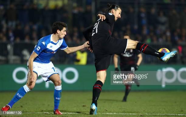 Zlatan Ibrahimovic of AC Milan competes for the ball with Andrea Cistana of Brescia Calcio during the Serie A match between Brescia Calcio and AC...