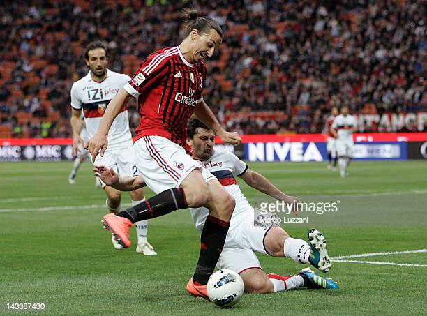 Zlatan Ibrahimovic of AC Milan competes for the ball with Kakha Kaladze of Genoa CFC during the Serie A match between AC Milan and Genoa CFC at...