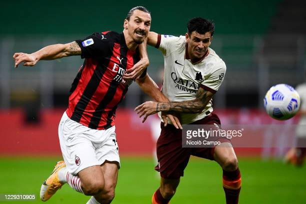 Zlatan Ibrahimovic of AC Milan competes for the ball with Roger Ibanez of AS Roma during the Serie A football match between AC Milan and AS Roma The...
