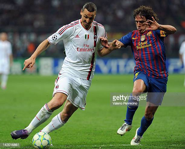 Zlatan Ibrahimovic of AC Milan in action against Carles Puyol of FC Barcelona during the UEFA Champions League quarter final first leg match between...