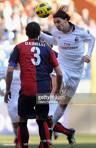 Zlatan Ibrahimovic of AC Milan in competes against Dario Dainelli of Genoa CFC during the Serie A match between Genoa CFC and AC Milan at Stadio...
