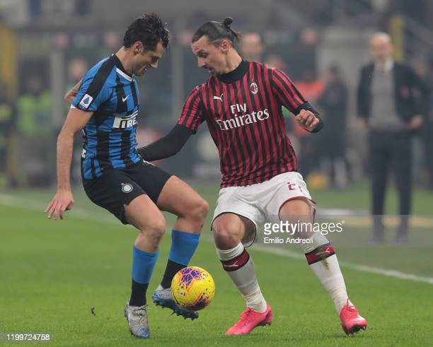Zlatan Ibrahimovic of AC Milan is challenged by Antonio Candreva of FC Internazionale during the Serie A match between FC Internazionale and AC Milan...